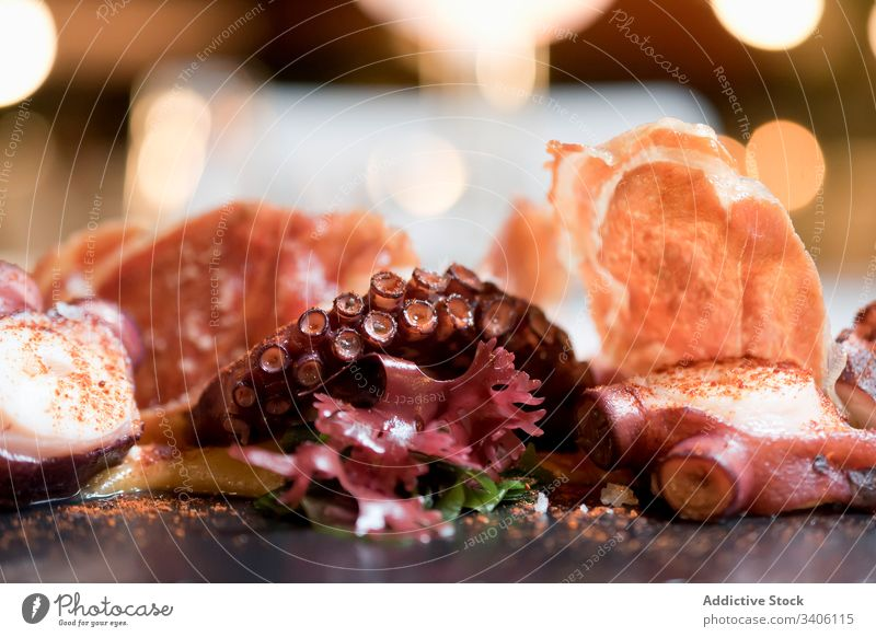Octopus tentacles served in restaurant octopus seafood dish spice fancy exquisite delicious cuisine meal tasty fresh dinner gourmet lunch yummy portion table