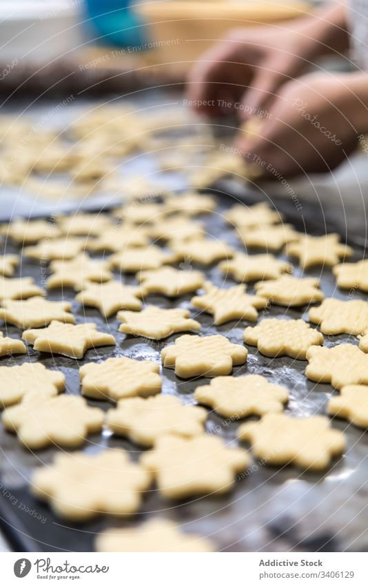 Crop baker making cookies on table cut bakery dough flour chef work cutter tool food kitchen pastry ingredient prepare sweet recipe cuisine biscuit shape fresh