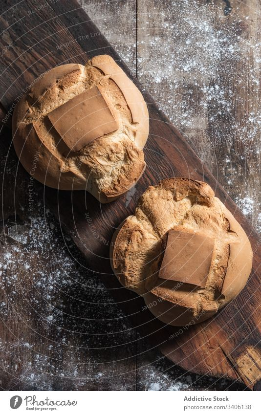 Fresh bread on wooden board bakery fresh table old rustic flour food baked homemade pastry cuisine delicious tasty loaf tradition crust gourmet composition