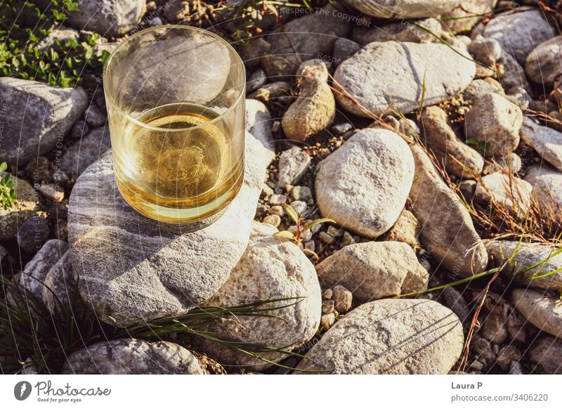 Close up of a glass with whiskey on some rocks close up rum Alcoholic drinks Beverage Bourbon Drinking nature concept relax relaxation Refreshment