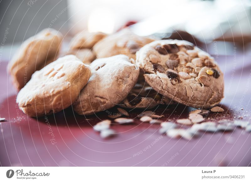 Close up of delicious home-made baked sweets close up Bakery shop Baked goods dessert biscuits tasty food snack fresh raw healthy chocolate raisins baking brown