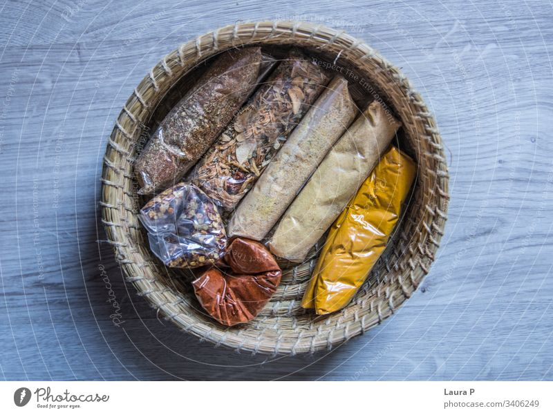 Top view of a round braided basket with condiments top view view from above seen from above top viewturmeric yellow Cooking Rustic food and drink Cinnamon