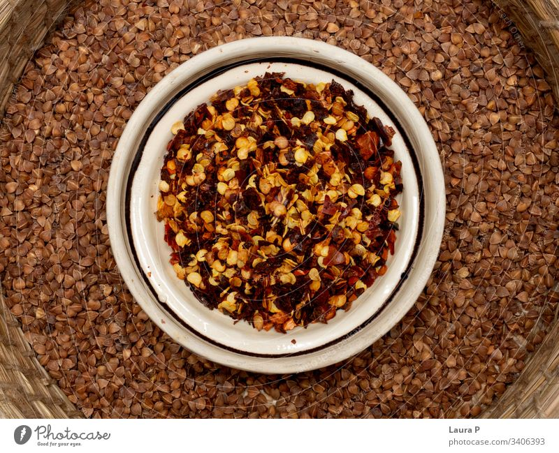 Close up of condiments in a round bowl - chilli and buckwheat close up spices herbs rustic delicious food nutrition vegetable raw diet healthy Vegan diet