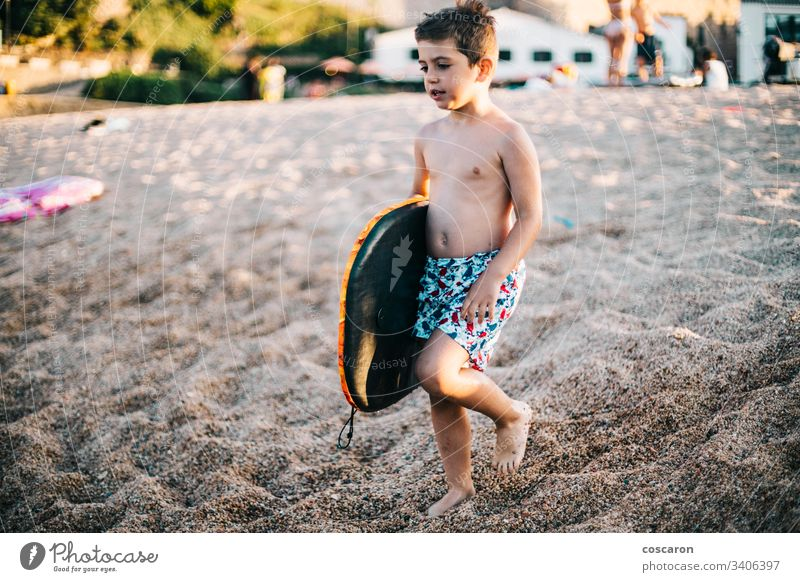 Little boy with a surfboard on the beach active caucasian child childhood coast colorful cute enjoying fun happiness happy kid kite leisure lifestyle little