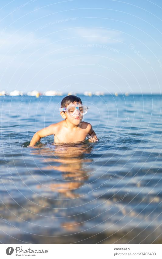 Funny kid with diving goggles on the beach active activity blue boy cheerful child childhood cute diver expressive fun happiness happy holiday holyday joy laugh