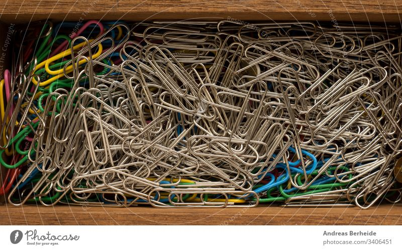Close up of paper clips in a wooden box organization steel nobody chrome fastener close-up wire iron color togetherness supply multi stationery connection group
