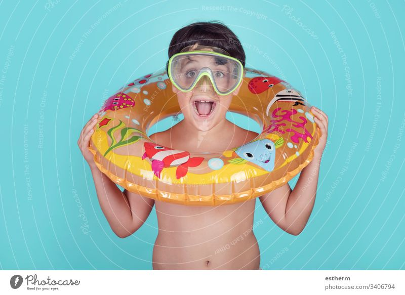 Funny child smiling with float ring summer pool cheerful joy happy happiness holidays lifestyle expression relax smile swimsuit swimming inflatable travel trip