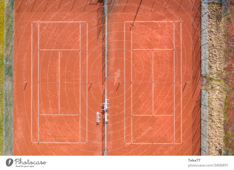 tennis court from above sport sports tennis courts ash orange white lines sun shadow summer winter sharp tennis net tennis nets ball balls tennis ball trees