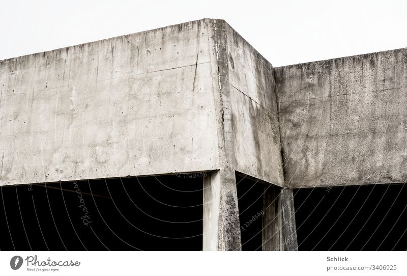 Simple concrete structure with corners on two thin supports Manmade structures Concrete Abstract Corners props high contrast areas Concrete walls angles
