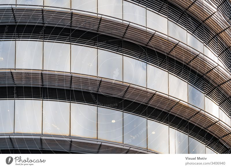 Light reflections on the curved glass of the windows of an office building abstract abstract background abstract photography afternoon architectonic