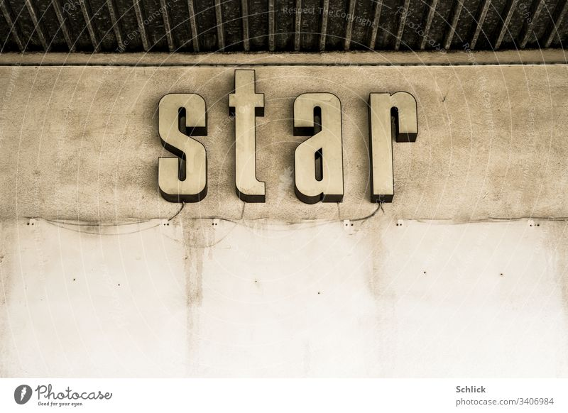 Old neon sign Word star on concrete wall Starling Wall (building) Concrete dilapidated publicity Neon sign background Gloomy colourless Advertising bankrupt