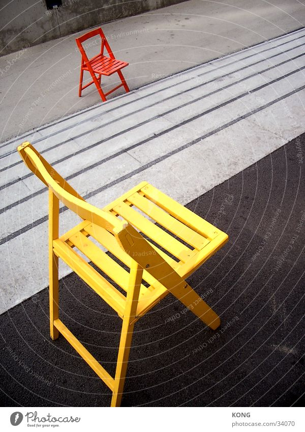 Dumped? Chair Yellow Loneliness Asphalt Multicoloured Flashy Things Orange Colour Stairs