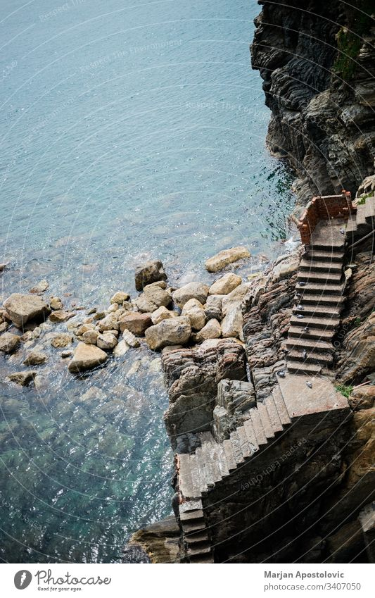 Stairs leading to the sea entrance on a rocky cliff adriatic background bay beach beautiful birds blue coast coastline concrete empty europe italy landscape