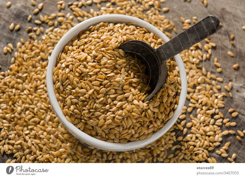 Golden flax seeds agriculture barley bowl brown buckwheat cereal dry food grain groats healthy heap ingredient isolated organic raw scoop vegetarian white