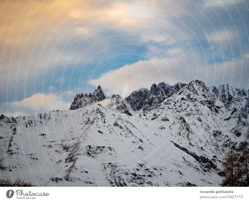 mountain sky Profile landscape Deserted clouds snow Nature cold freeze ice Winter Environment mountain scape colorful sky high sun daylight calm Snow Frost