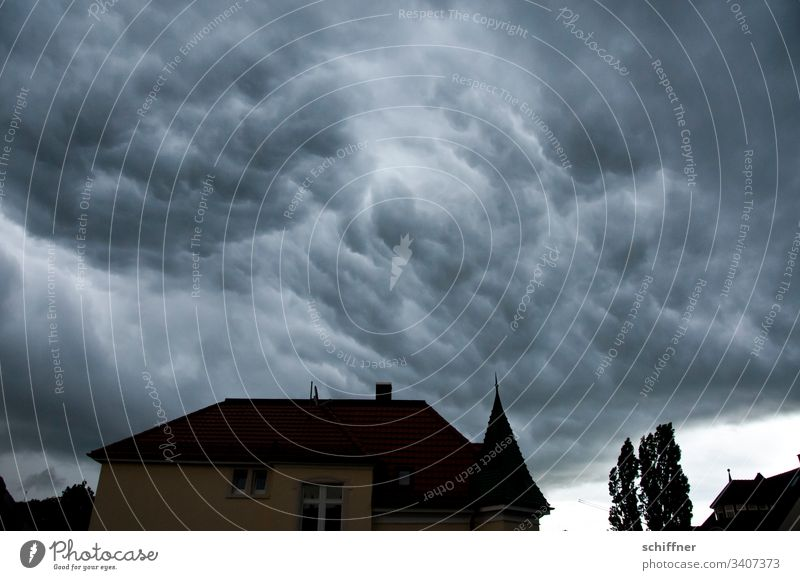 Silhouette of a house before storm clouds House (Residential Structure) Villa Tree Bad weather Bad weather front Clouds Cloud cover Cloud formation