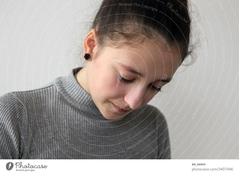 Portrait girl Child Human being Colour photo 1 Downward Infancy Youth (Young adults) Feminine brunette concentrated Earring hollowed Gray Handicraft Draw