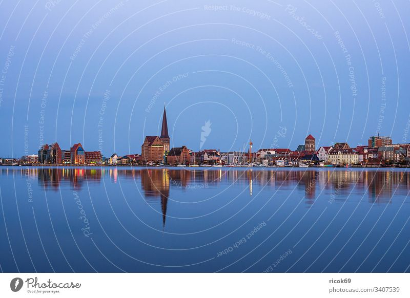View over the Warnow river to the city of Rostock in the evening Town River Mecklenburg-Western Pomerania Warnov city harbour Architecture houses Building