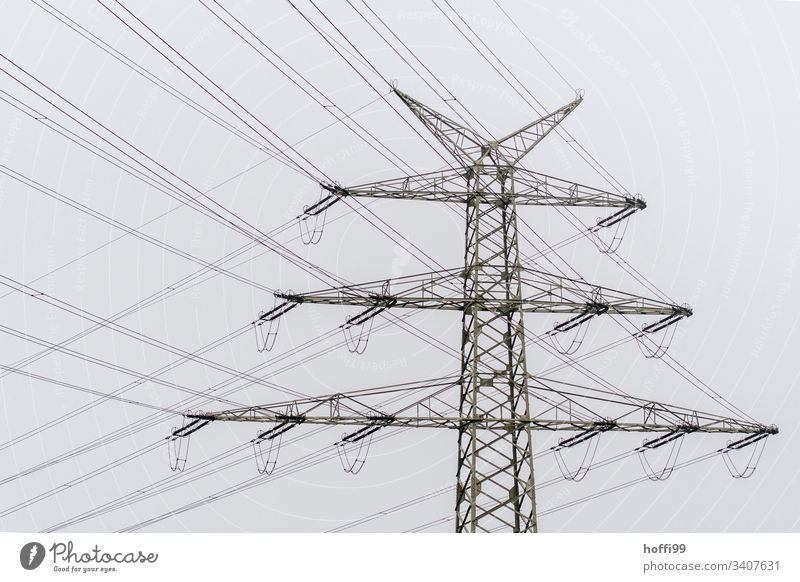 Power pole with many cables Electricity High voltage power line Electricity pylon Transmission lines Energy industry Overhead line Power transmission Insulation