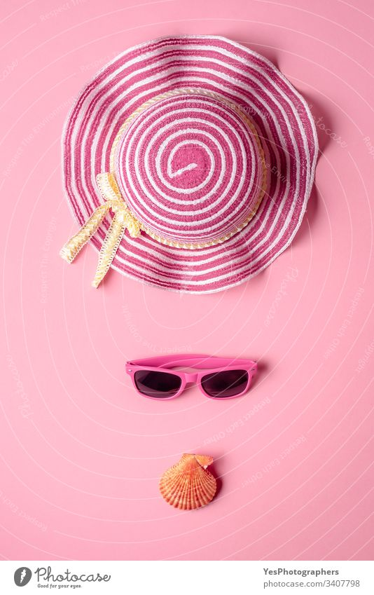 Girly beach accessories on pink background. Minimalist above view banner composition concept eyewear fashion flat lay frame girly hat heat holiday hot isolated