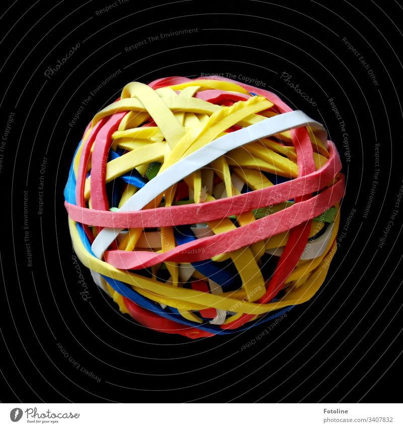 The object of desire - A ball of rubber bands on a brown blanket household rubbers Shallow depth of field Colour photo Deserted Close-up Ball Sphere variegated