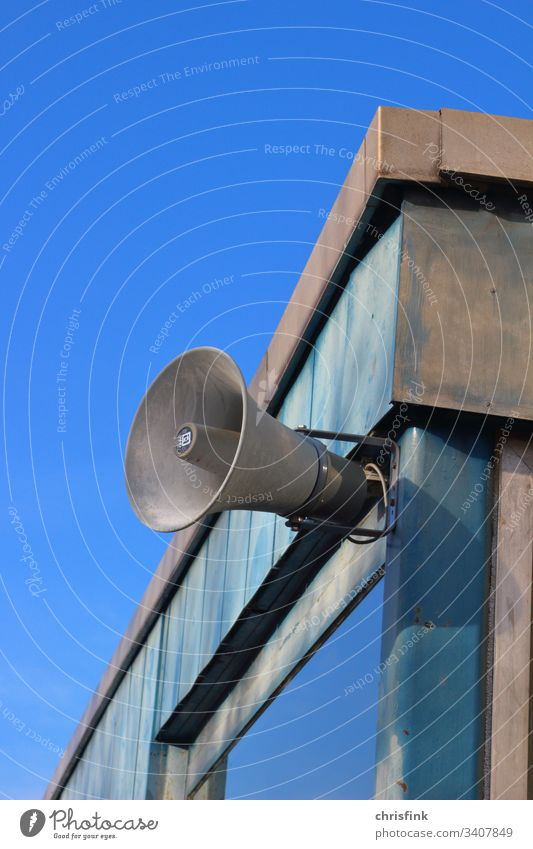 Loudspeaker on house wall in front of sky Megaphone Music announcement jail quiet Clang Noise Company db decibel sound sound level noise rest Disturbance