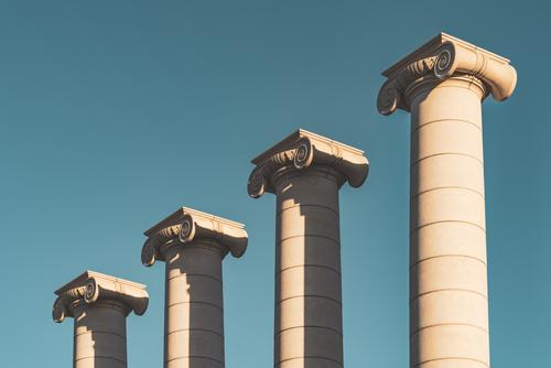 Four Ionic style columns against the blue sky color four ionic ionic style architecture architectural architectonic outdoor exterior urban art fair weather