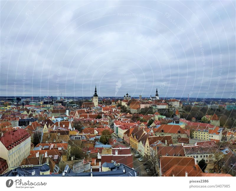 Grey sky over upper and lower town of Tallinn estonia architecture church cityscape view building landmark tower urban panorama old tallinn europe cathedral