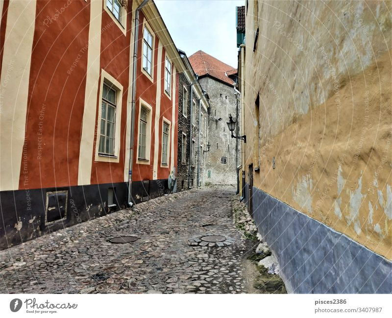 Beautiful old street in the city center of Tallinn town baltic european historic famous roof sightseeing tallinn medieval downtown evening travel wall landscape