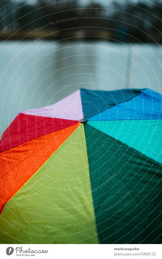 Colourful umbrella Rain Rainy weather Foul weather raindrops variegated Prismatic colors Wet