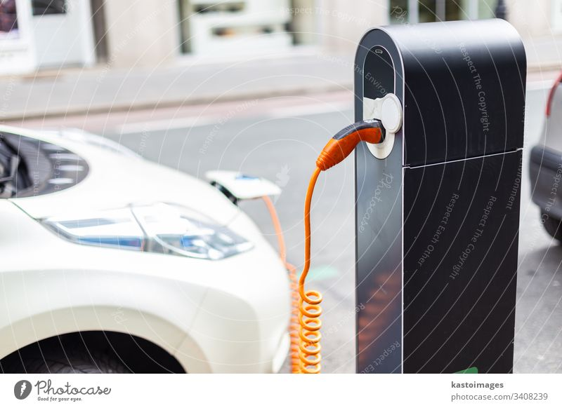 Power supply for electric car charging. Electric car charging station. Close up of the power supply plugged into an electric car being charged. vehicle eco