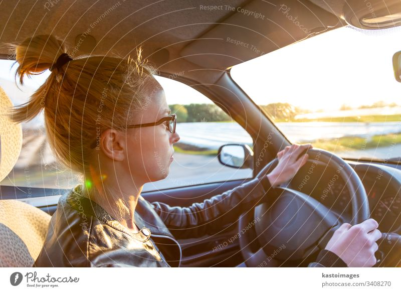 Casual caucasian woman driving passenger car for a journey in countryside. drive driver transport adult female transportation spring travel fun lady girl
