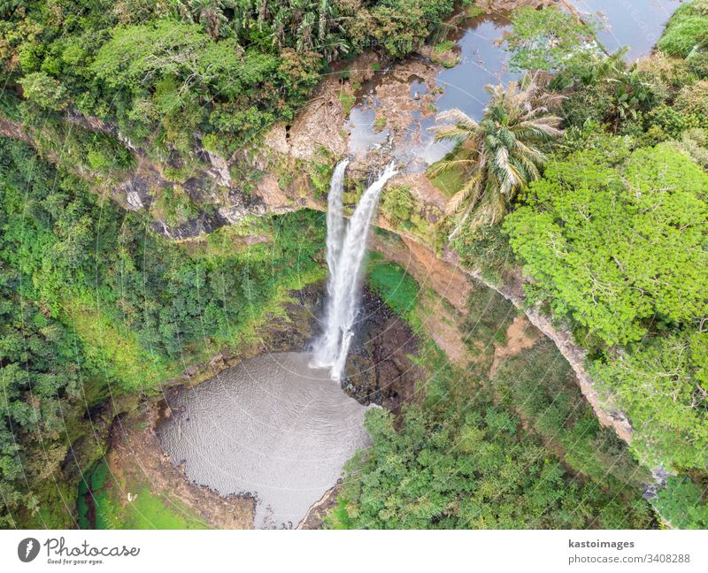 Aerial top view perspective of Chamarel Waterfall in the tropical island jungle of Mauritius. chamarel waterfall mauritius africa flowing forest green landscape
