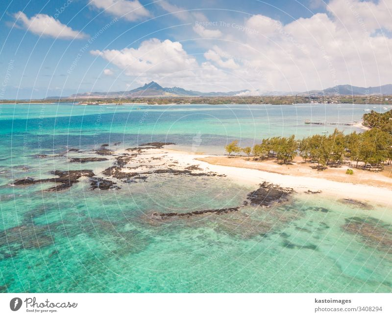 Aerial view of beautiful tropical beach with turquoise sea. Tropical vacation paradise destination of D'eau Douce and Ile aux Cerfs Mauritius Trou Deau Douce