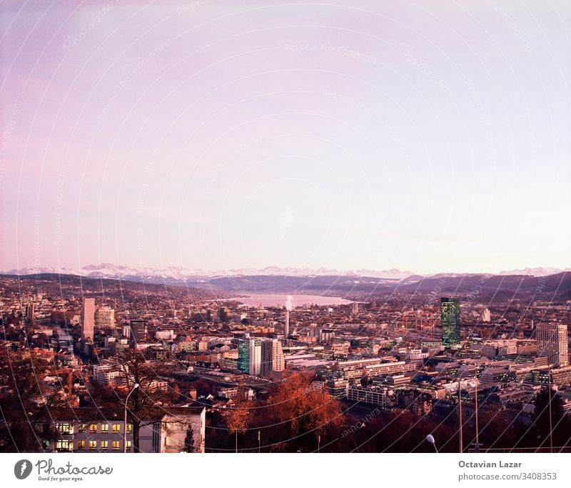 Zurich Zuerich city scape from high vantage point, autumn, pink light fall above foliage sunset zurich switzerland vista view downtown swiss tourism cityscape