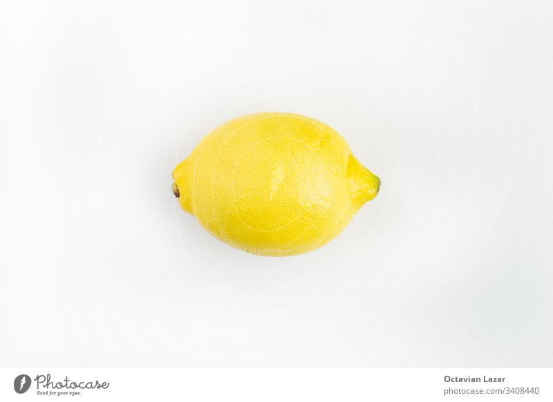 Ripe whole lemon isolated on white yellow ripe food fruit citrus vegetarian ingredient organic healthy tropical peel sour color full nature view vibrant closeup