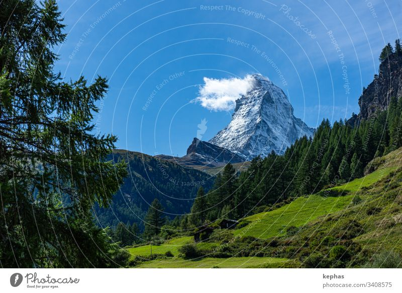"The Matterhorn with the famous ""Matterhorn cloud mountain mountains Switzerland Swiss Alps Zermatt Tourism holidays valais Canton Wallis Valais Alps outdoor"