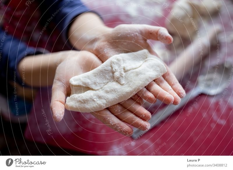 Close up of child hands next to a rolling pin, playing with dough desert Preparation Raw Kitchen Close-up adorable cute sweet close up little baking cooking