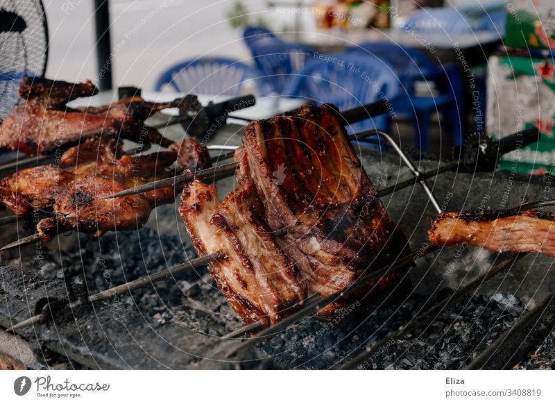 spit-roasted meat meat consumption Meat speared Barbecue (apparatus) BBQ Frying Delicious Hot Embers BBQ season Nutrition Grill Food Charcoal (cooking) Summer