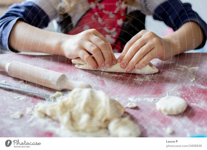Close up of little girl's hands playing with dough close up baking cooking fingers child kid toddler Colour photo Baked goods Flour sweets home-made food