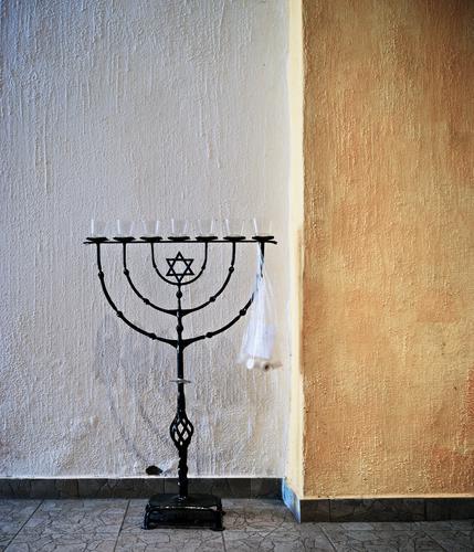 Menorah, misused menorah Menorah-im Candlestick Judaism symbol Interior shot Stand Metal forged Art Star of David Wall (barrier) Wall (building) floor Deserted