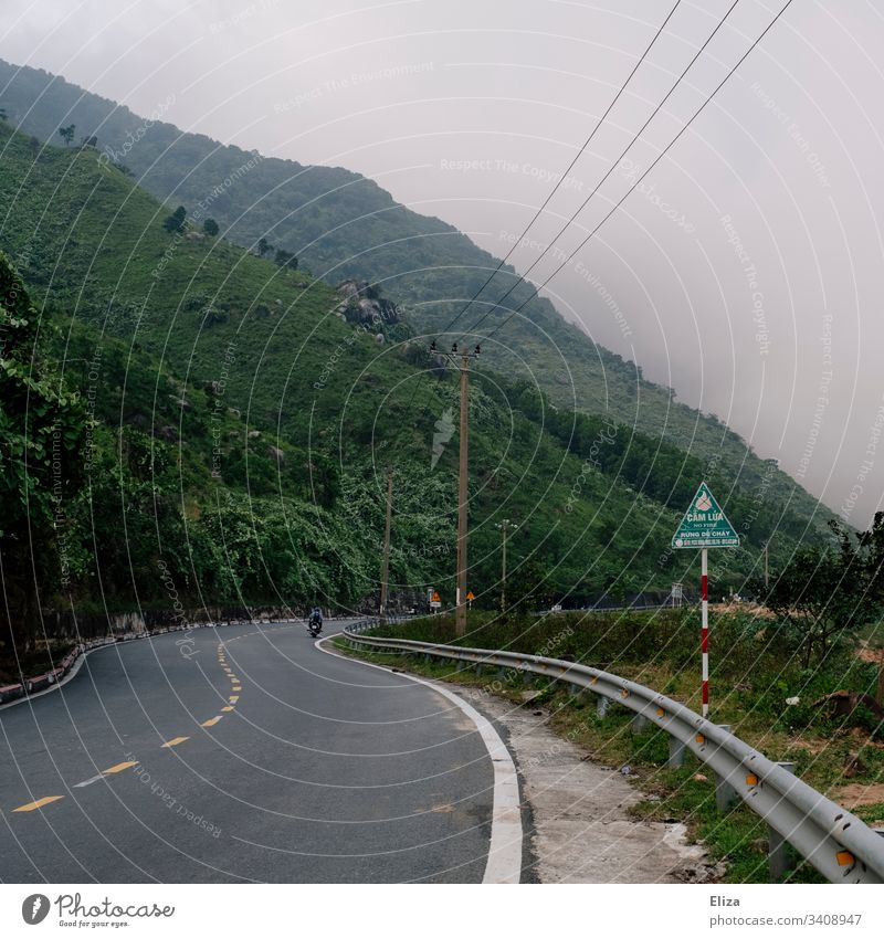 A road in Vietnam leading up to the Cloud Pass amidst green mountains and clouds Street Green Nature Exterior shot Colour photo Landscape Vacation & Travel