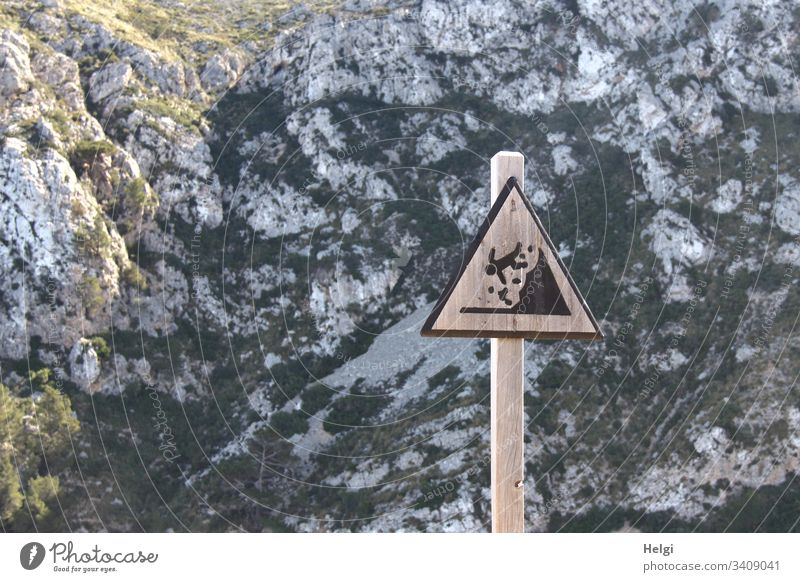 Warning sign Caution Danger of falling from rocks in the Tramuntana Mountains on Mallorca esteem Risk of collapse peril Signage Signs and labeling Threat Safety
