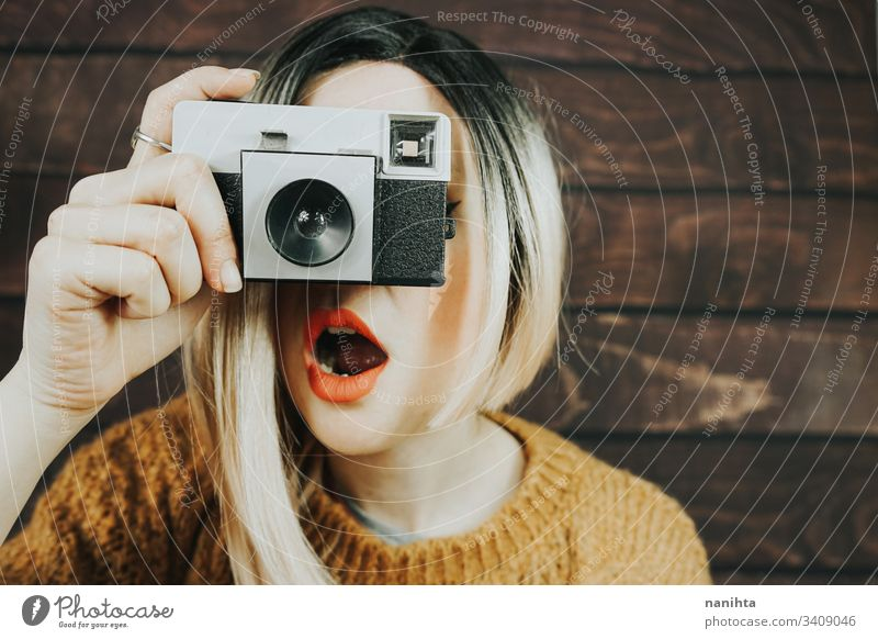 Young woman taking photographies with an analog camera vintage photography photographer cool trendy retro young youth artits fresh freshness ombre style