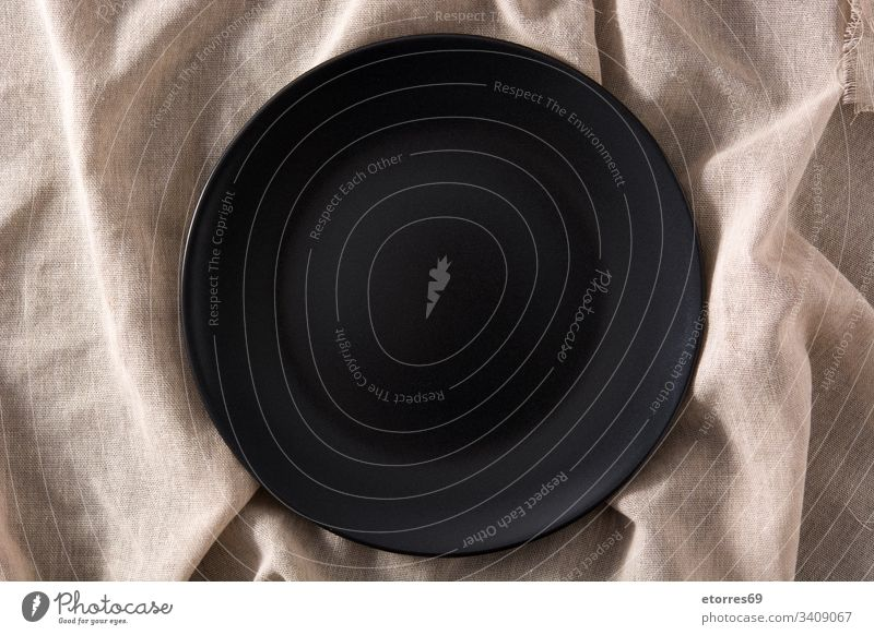 Empty black plate on brown cloth top view background bowl crockery empty food iron kitchen mockup object slate Crockery