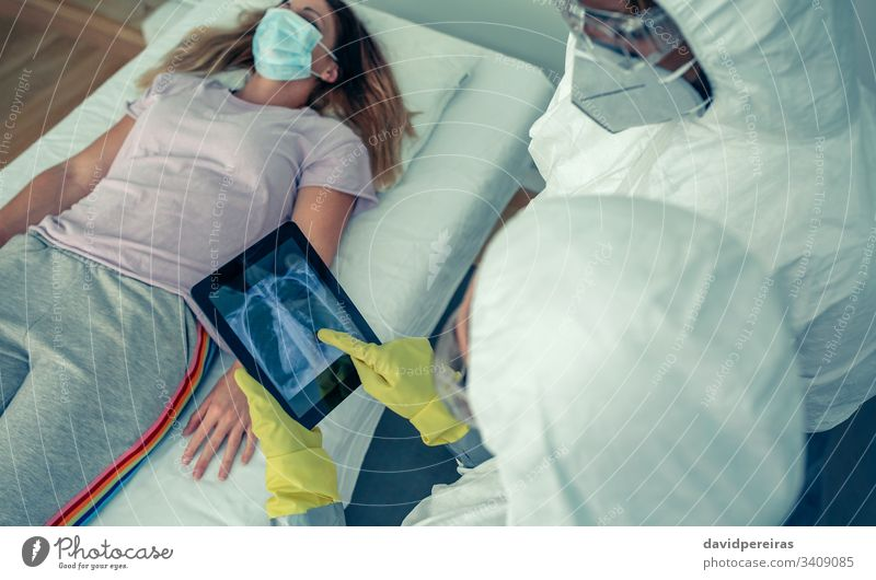 Doctors examining a patient's chest x-ray checkup respiratory virus covid-19 lungs radiography respiratory problems coronavirus thorax diagnose doctor hospital