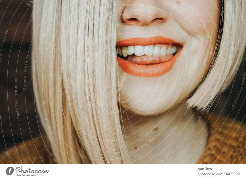 Close up of the hair and lips of a young woman hairstyle sensual close up face pretty blonde matte lipstick skin care cosmetics real part of portrait real woman