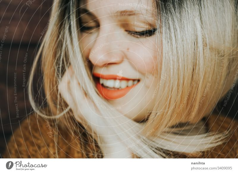 Close up of a beautiful young and cool woman emotion pretty face youth hairstyle modern casual blonde trendy fresh freshness happy sensual caucasian white