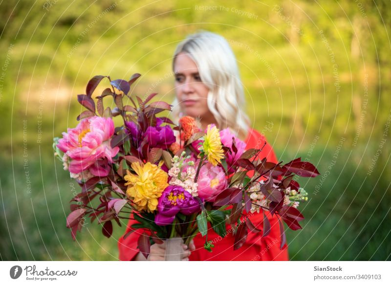 Beautiful blonde florist woman hold wonderful bouquet Half-profile Portrait photograph Day Morning Enthusiasm Euphoria Colour photo Happiness Human being