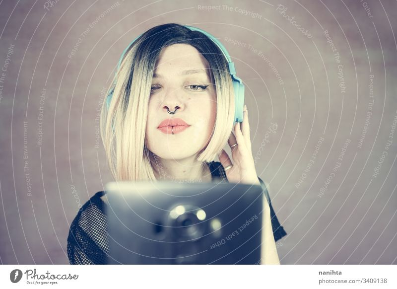 Young modern woman listening to music technology enjoy fresh headphones piercing headset cool freshness youth hobby leisure time portrait portraiture people